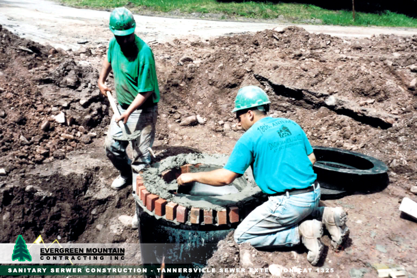 sanitary-serwer-construction-tannersville-sewer_-extention-cat_-1325-evergreen-mountain-contracting-new_-york_-petosa-manhole